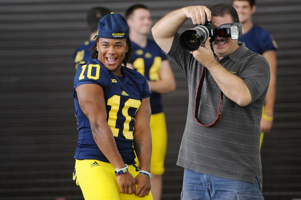 Michigan junior wide receiver Jeremy Gallon goofs around as he attempts to distract junior quarterback Devin Gardner as he has his photo taken during media day at the Al Glick Field House on Sunday afternoon. Melanie Maxwell I AnnArbor.com