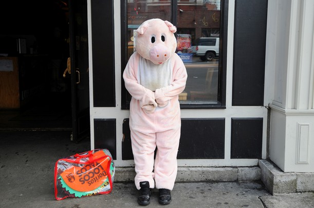 A pig mascot takes a break outside a bar on Broadway in downtown Nashville, Tenn. on Friday. Michigan is set to take on Ohio University at 7:20 p.m. Melanie Maxwell I AnnArbor.com