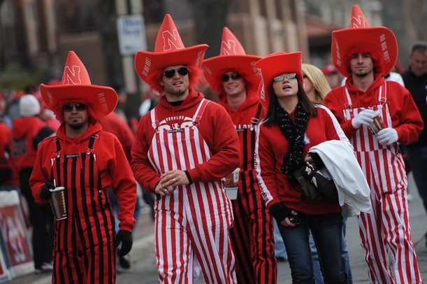 Nebraska fans show their team pride with stripes and cowboy hats as they walk outside Memorial Stadium in Lincoln, Nebraska on Saturday. Melanie Maxwell I AnnArbor.com