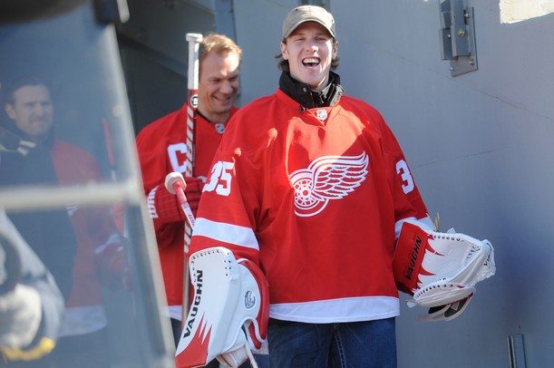 Red Wings goaltender Jimmy Howard smiles as he exits the tunnel and makes his way onto the field at Michigan Stadium for a press conference announcing the 2013 Winter Classic on Thursday afternoon. Melanie Maxwell I AnnArbor.com