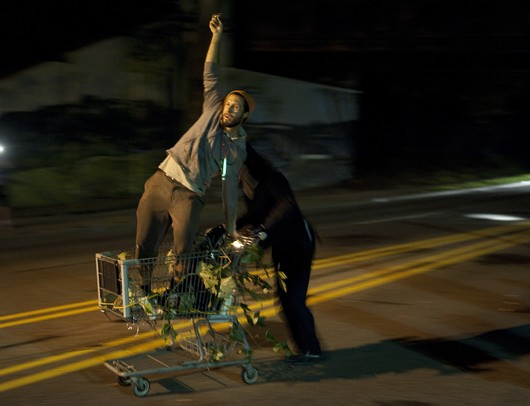 Team Far House takes a victory lap after winning the 2012 Shopping Cart Race Tuesday night. Daniel Brenner I AnnArbor.com