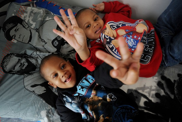 Four-year-old twin brothers Caine and Carter Flowers pose for a photo. The pair will celebrate their fourth birthday on Leap Day, February 29.  Melanie Maxwell I AnnArbor.com