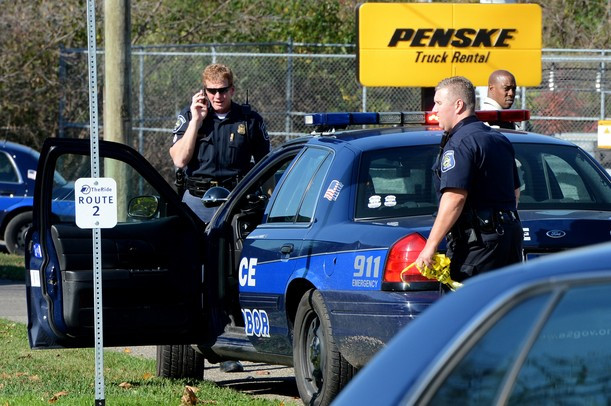Ann Arbor police work the scene outside of Penske Truck Rental where a vehicle and body were found Thursday. Melanie Maxwell I AnnArbor.com
