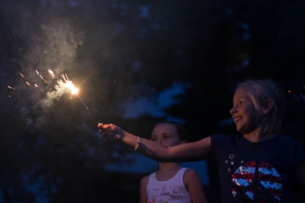 8-year-old Lilli Howe plays with a sparkler before Manchester's annual fireworks show at Carr Park, July 3.