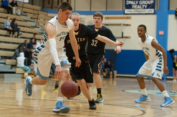 Skyline's Peter Bakker-Arkema dribbles the ball back down court during their game against Dexter Tuesday Feb. 12th.