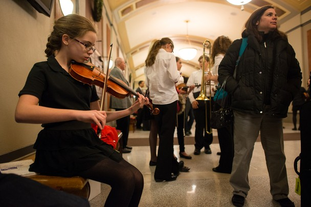 Forsythe seventh-grader Gabrielle Hornak practices her violin in the lobby of the Hill Auditorium before the start of Orchestra night Thursday, Feb. 14. 
