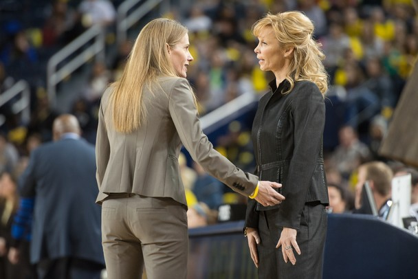 Wolverines head coach Kim Barnes Arico speaks with Spartans head coach Suzy Merchant before the start of their game Saturday Feb. 16th.