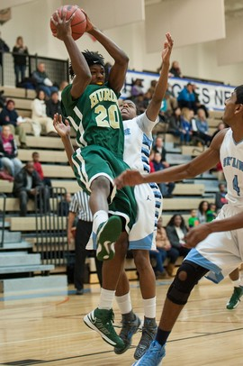 Huron's Demetrius Sims jumps to make a rebound during the first half of their game against Skyline Tuesday night.