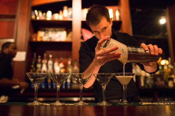 Bab's Underground Lounge bartender Josh Haske pours out a Mintini — a special martini made for the Ann Arbor Art Center's Artini Martini Crawl Friday Feb. 22.