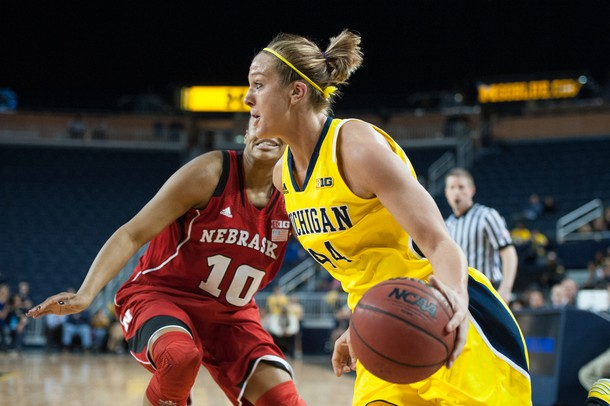 Wolverines Rachel Sheffer dribbles the ball past Cornhuskers Meghin Williams  during the first half of their game Thursday night.