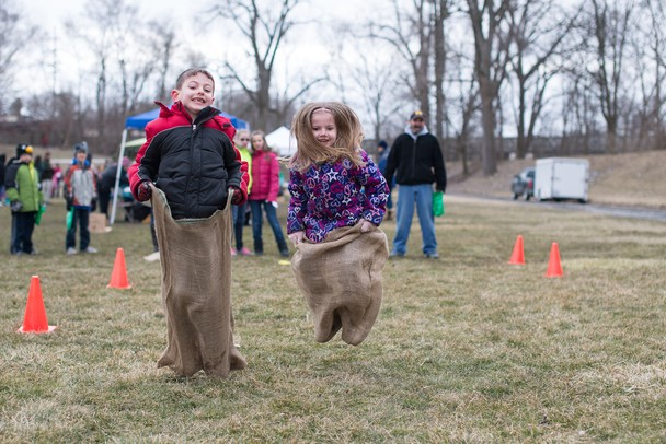 Nickolas Hurd races his younger sister Olivia during the Jaycees Easter Egg Scramble and Marshmallow Drop at Frog Island Park in Ypsilanti on Saturday March 23. Courtney Sacco I AnnArbor.com