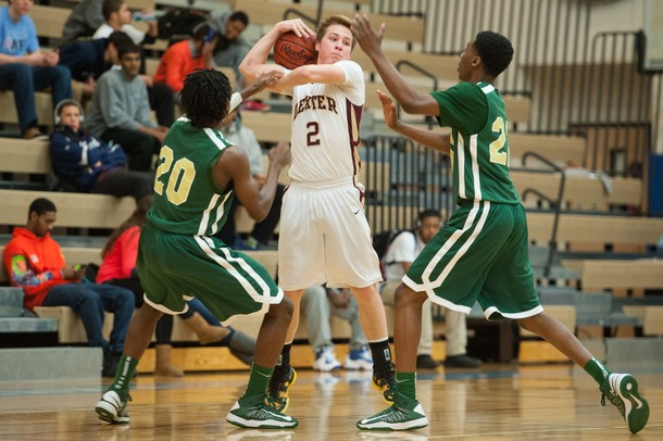 Dexter's Brandon Bellottie looks for an open team mate as he is guarded by Huron's Demetrius Sims and Xavier Cochran during the first half of the Class A district semifinals at Skyline High School Wednesday Mar. 6th.