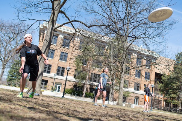 Becky Moore, a senior at the University of Michigan tosses around a frisbee on the Diag on Saturday, March 30.