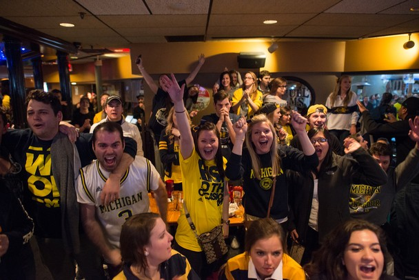 Wolverines fans cheer during the last few minutes of the Final Four game against Syracuse at Good Time Charley's  on South University Avenue on Saturday night. Courtney Sacco I AnnArbor.com
