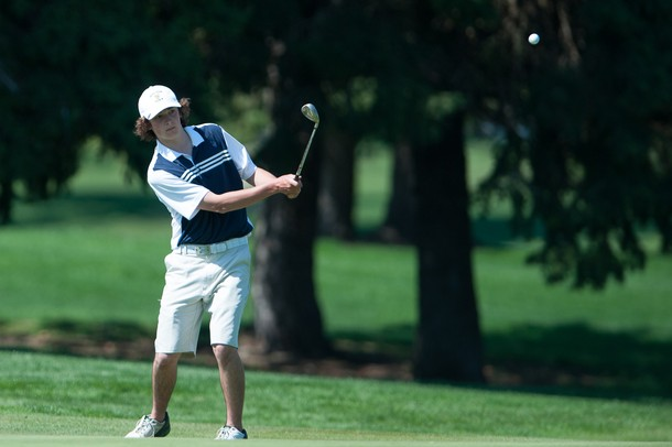 Saline's Alex Derksen makes a chip shot on the 10th hole during the golf match at the University of Michigan golf course Wednesday May, 1.