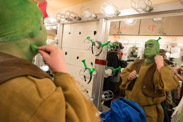 Leading actor in Pioneer's 'Shrek the Musical' Skyline senior Andrew Nazzaro puts on green makeup before Friday night's performance.