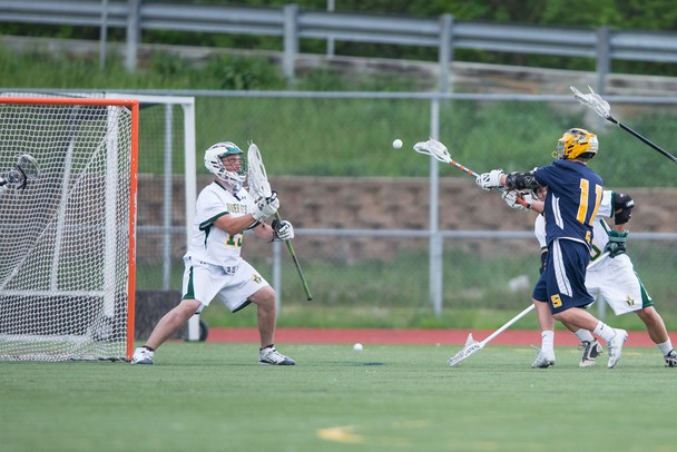 Saline's Brett Braun shoots the ball at Huron's net during their game a Huron high school Wednesday, May 8.