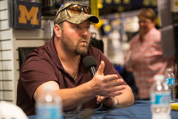 Former Wolverines football player Glen Steele speaks during the Mott Takeover telethon on WTKA at the MDen Friday May 17.