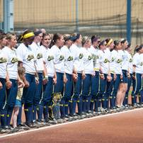 The University of Michigan Wolverines line up for the national anthem before the start of their game against California, Saturday May 18.