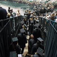A graduate looks up at the audience as the 2013 class enters Convocation Center Saturday, May 18.