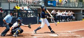 Wolverines pitcher sophomore Sara Driesenga hits the ball during the second inning of the NCAA regional title game against California, Sunday May 19.