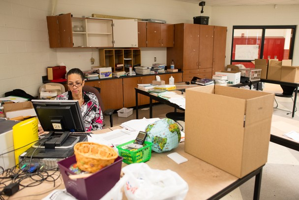 Rhonda Williams, a teacher at Willow Run Middle School for 29 years, sits in her half-packed classroom on the school's last day open, Friday, June 7.