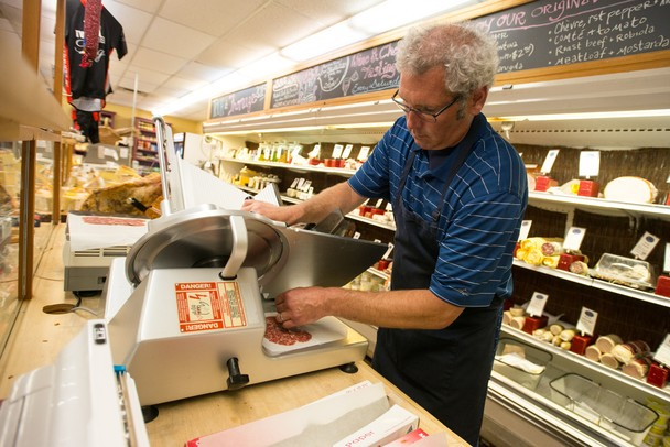 Tommy York uses the deli slicer at Morgan and York in Ann Arbor.
