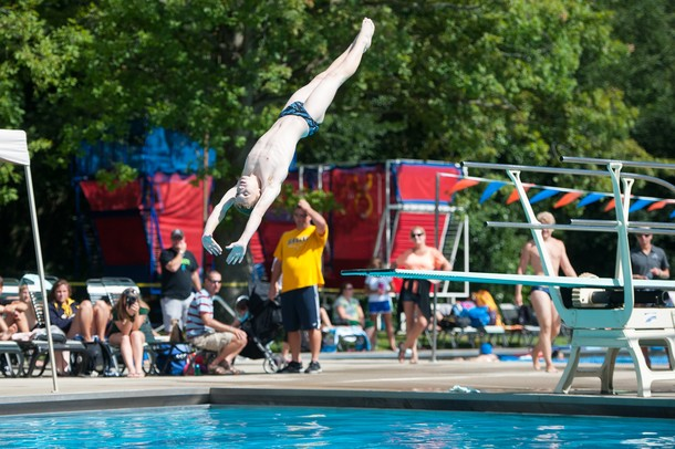 Matt S. jumps off the board during the 15 and over diving portion of the WISC championships, at the Huron Valley Swim Club in Ann Arbor, Wednesday, July 24.