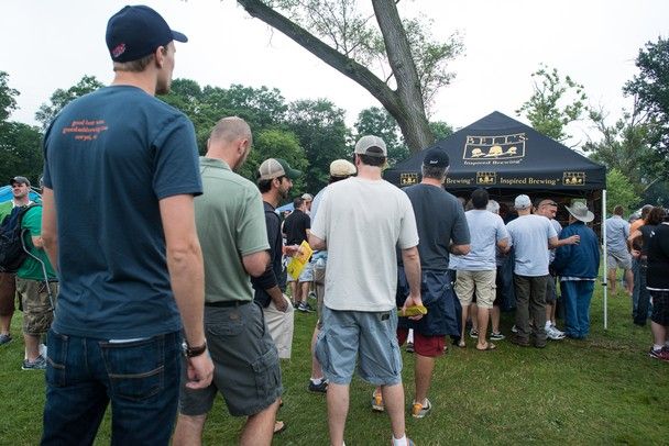 Beer fans line up to sample beer from Bell's Brewery at the Michigan Summer Beer Festival at Riverside Park in Ypsilanti, Saturday, July 27.