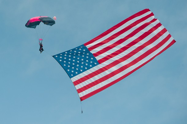 The Flag Drop during the Opening Ceremonies for the 2013 Thunder Over Michigan air show at the Willow Run airport, Saturday, August, 10.