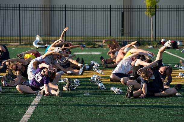 Members of the University of Michigan marching band stretch at the start of practice, Saturday, Aug, 24.