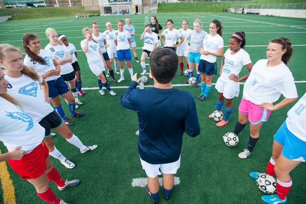 Head Coach Chris Morgan talks to his team during practice Wednesday May 22.