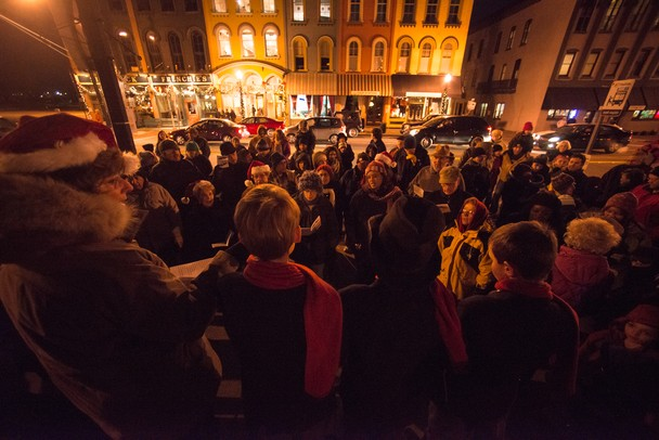 A large group gathered in the Depot Town section of Ypsilanti to sing christmas carols before the tree lighting ceremony Saturday night.