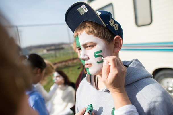 Jack Jonson the younger brother of The Fighting Irish's Matt Johnson has his brothers number painted on his face before Saturday afternoons Division 5 state semifinals game against Portland high school.