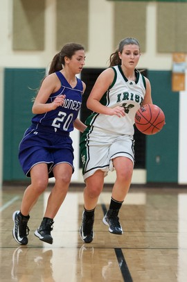 The Irish's Rachel DeMarco drives the ball down court against Pioneer's Jennifer Fichera duringThursday evenings game at Father Gabriel Richard High School.