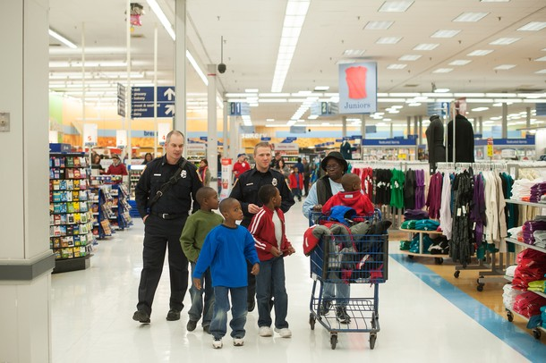 Pittsfield firefighters Craig Liggett and Dan Olson walk through Meijer with the Zirker boys during this years shop with a hero event.