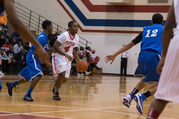 The Flyers DaQuanta Brown dribbles the ball down court during Friday nights game against Lincoln High School.