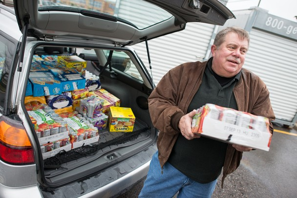 Warren Hughes helps unload canned goods to be donated to the 2012 Rockin' for the Hungry Food Drive. Courtney Sacco I AnnArbor.com