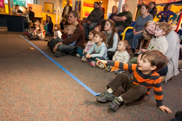Families watch the Flame and Freezing Science Demo at the Ann Arbor Hands-On Museum Saturday Jan. 5. 