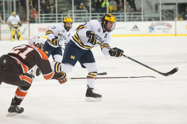 The Wolverines defensemen Lee Moffie passes the puck against The Bowling Green Falcons, Tuesday Jan. 8.