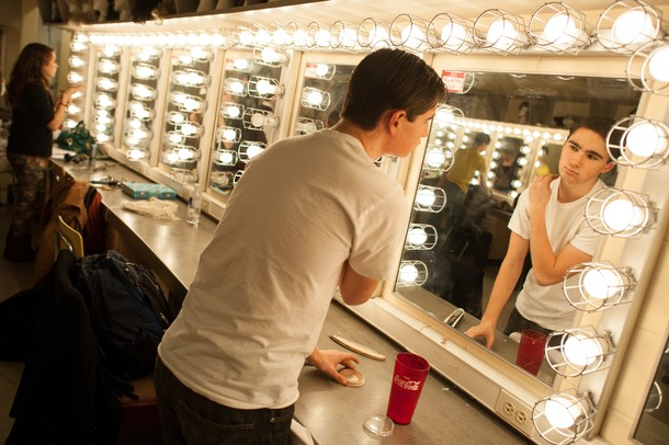 "Looking in the mirror, Huron High School student Matt Egeler puts on his makeup as he prepares for the dress rehearsal of  ""The Musical Comedy Murders of 1940.""