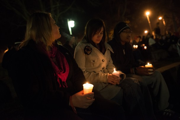 Friends, classmates and family members of Julia Niswender held a candle light vigil in memory of her outside of Big Bob's Lake house at Eastern Michigan University Friday night.