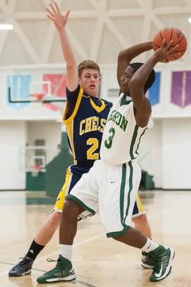 Huron's Yontae Jackson passes the ball against Chelsea's Cam Starkey during Friday nights.