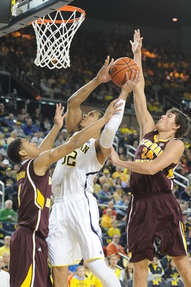 Michigan Junior Jordan Morgan jumps to make a basket against Central Michigan during the first half of the game on Saturday Dec. 29.