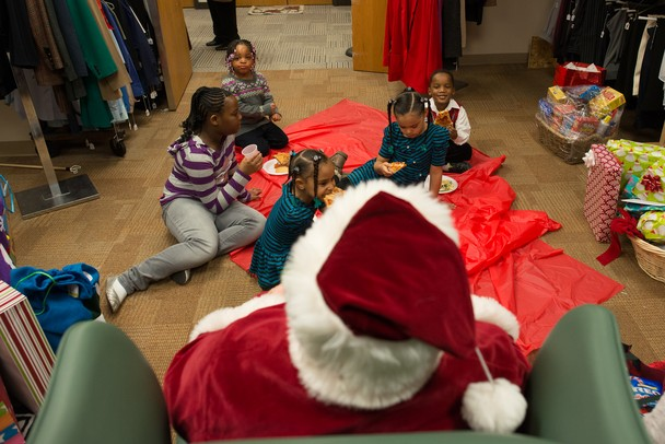 Kids ate pizza and cookies with Santa before he handed out toys Saturday afternoon at Dress For Success Michigan in Ypsilanti. 