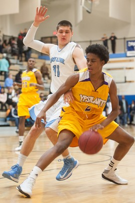 Ypsilanti's Justin Bernard dribbles the ball past Skyline's Peter Bakker-Arkema during their game at Skiyline High school Tuesday, Jan. 15.