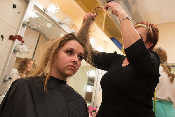 Hannah Hesseltine has her hair done backstage before the Futurestars Finals at Pioneer High School Saturday, Jan 19.