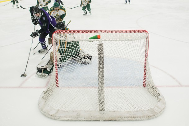 Pioneer's Anthony Moran shoots the puck to score Pioneer's first goal against Huron, Saturday Jan 19.
