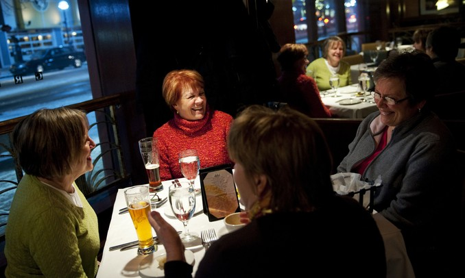 Debbie Kovacevich, Loreli Papke, Julie Panek, and Jean Shlafer (left to right) shared a meal and a whole lot  of laughs when they brought their regular girls' night gathering to Gratzi for Restaurant Week on Monday, Jan. 21. Daniel Brenner I AnnArbor.com