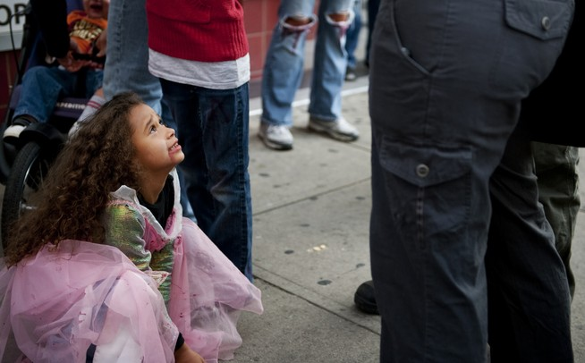 Ahnia Logan, six, pretends to be a zombie in the Ann Arbor Zombie Walk on Saturday. Daniel Brenner I AnnArbor.com